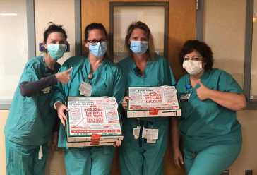 nurses with pizza