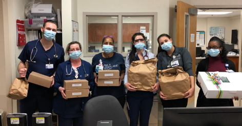 nurses with food packages